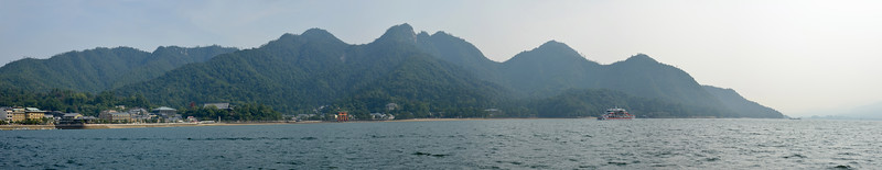 """Pano image Miyajima Island - Itsukushima Shrine (Japanese: 厳島神社 Itsukushima-jinja) is a Shinto shrine on the island of Itsukushima (popularly known as Miyajima), best known for its """"floating"""" torii gate. It is in the city of Hatsukaichi in Hiroshima Prefecture in Japan. The shrine complex is listed as a UNESCO World Heritage Site, and the Japanese government has designated several buildings and possessions as National Treasures.<br /> <br /> Itsukushima jinja was the chief Shinto shrine (ichinomiya) of Aki Province. The shrine has been destroyed many times, but the first shrine buildings were probably erected in the 6th century. The present shrine dates from the mid-16th century, and is believed to follow an earlier design from the 12th century.That design was established in 1168, when funds were provided by the warlord Taira no Kiyomori. Miyajima (宮島町) is a town located on the island of Itsukushima in Saeki District, Hiroshima Prefecture, Japan."""
