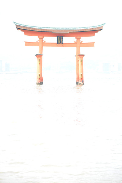 "Miyajima Tori in high key. Itsukushima Shrine (Japanese: 厳島神社 Itsukushima-jinja) is a Shinto shrine on the island of Itsukushima (popularly known as Miyajima), best known for its ""floating"" torii gate. It is in the city of Hatsukaichi in Hiroshima Prefecture in Japan. The shrine complex is listed as a UNESCO World Heritage Site, and the Japanese government has designated several buildings and possessions as National Treasures.<br /> <br /> Itsukushima jinja was the chief Shinto shrine (ichinomiya) of Aki Province. The shrine has been destroyed many times, but the first shrine buildings were probably erected in the 6th century. The present shrine dates from the mid-16th century, and is believed to follow an earlier design from the 12th century.That design was established in 1168, when funds were provided by the warlord Taira no Kiyomori. Miyajima (宮島町) is a town located on the island of Itsukushima in Saeki District, Hiroshima Prefecture, Japan."