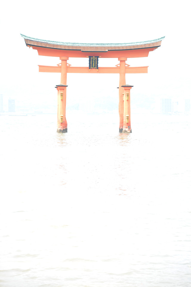 """Miyajima Tori in high key. Itsukushima Shrine (Japanese: 厳島神社 Itsukushima-jinja) is a Shinto shrine on the island of Itsukushima (popularly known as Miyajima), best known for its """"floating"""" torii gate. It is in the city of Hatsukaichi in Hiroshima Prefecture in Japan. The shrine complex is listed as a UNESCO World Heritage Site, and the Japanese government has designated several buildings and possessions as National Treasures.<br /> <br /> Itsukushima jinja was the chief Shinto shrine (ichinomiya) of Aki Province. The shrine has been destroyed many times, but the first shrine buildings were probably erected in the 6th century. The present shrine dates from the mid-16th century, and is believed to follow an earlier design from the 12th century.That design was established in 1168, when funds were provided by the warlord Taira no Kiyomori. Miyajima (宮島町) is a town located on the island of Itsukushima in Saeki District, Hiroshima Prefecture, Japan."""