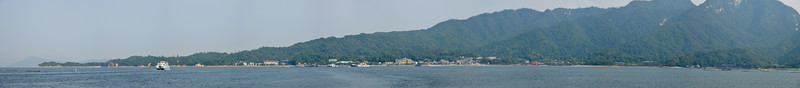 "Panoramic image of Miyajima Island - Itsukushima Shrine (Japanese: 厳島神社 Itsukushima-jinja) is a Shinto shrine on the island of Itsukushima (popularly known as Miyajima), best known for its ""floating"" torii gate. It is in the city of Hatsukaichi in Hiroshima Prefecture in Japan. The shrine complex is listed as a UNESCO World Heritage Site, and the Japanese government has designated several buildings and possessions as National Treasures.<br /> <br /> Itsukushima jinja was the chief Shinto shrine (ichinomiya) of Aki Province. The shrine has been destroyed many times, but the first shrine buildings were probably erected in the 6th century. The present shrine dates from the mid-16th century, and is believed to follow an earlier design from the 12th century.That design was established in 1168, when funds were provided by the warlord Taira no Kiyomori. Miyajima (宮島町) is a town located on the island of Itsukushima in Saeki District, Hiroshima Prefecture, Japan."