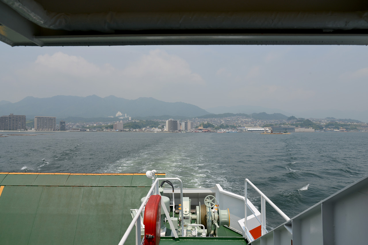 On our way from Hiroshima to Miyajima.<br /> <br /> Miyajima (宮島町) is a town located on the island of Itsukushima in Saeki District, Hiroshima Prefecture, Japan.<br /> <br /> Hiroshima (広島市) is the capital of Hiroshima Prefecture, and the largest city in the Chūgoku region of western Honshu, which is the largest island of Japan. It is recongnized as the first city in history to be targeted by a nuclear weapon when the United States Army Air Forces (USAAF) dropped an atomic bomb on it at 8:15 a.m. on August 6, 1945, near the end of World War II. Hiroshima is situated on the Ōta River delta, on Hiroshima Bay, facing the Seto Inland Sea on its south side. The river's six channels divide Hiroshima into several islets.