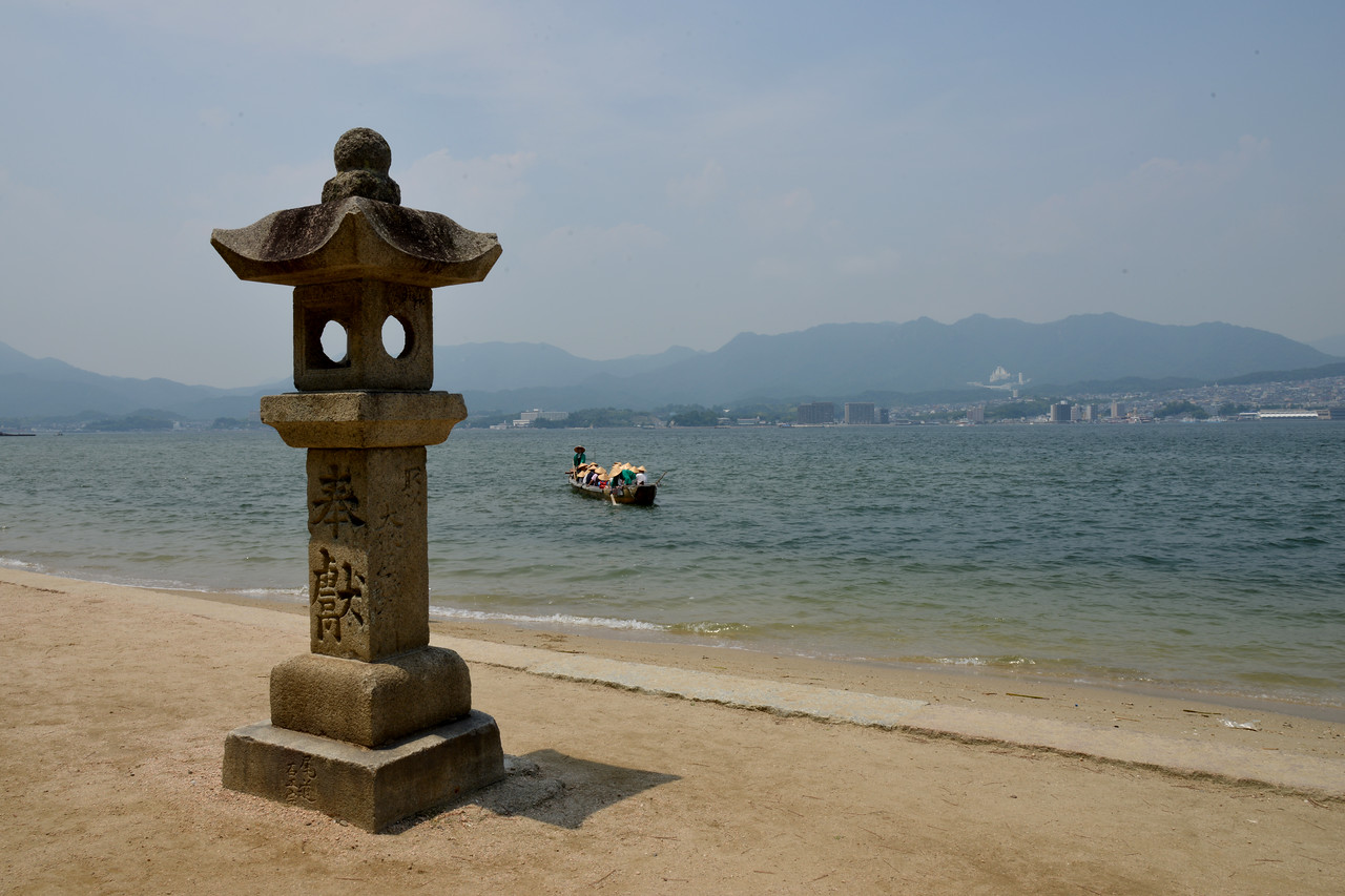 Miyajima (宮島町) is a town located on the island of Itsukushima in Saeki District, Hiroshima Prefecture, Japan.<br /> <br /> Hiroshima (広島市) is the capital of Hiroshima Prefecture, and the largest city in the Chūgoku region of western Honshu, which is the largest island of Japan. It is recongnized as the first city in history to be targeted by a nuclear weapon when the United States Army Air Forces (USAAF) dropped an atomic bomb on it at 8:15 a.m. on August 6, 1945, near the end of World War II. Hiroshima is situated on the Ōta River delta, on Hiroshima Bay, facing the Seto Inland Sea on its south side. The river's six channels divide Hiroshima into several islets.