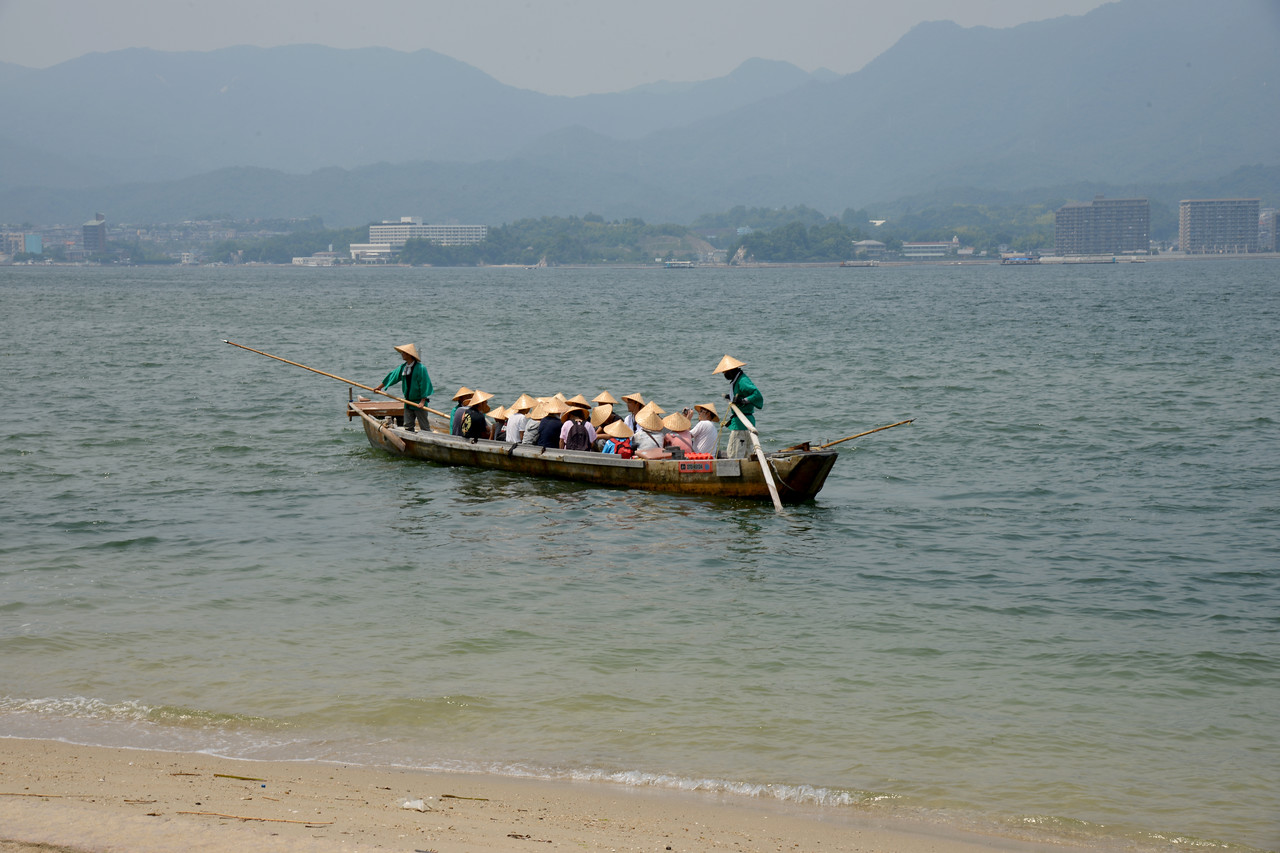 Boat ride brings you really close to the Tori at Miyajima Island. Miyajima (宮島町) is a town located on the island of Itsukushima in Saeki District, Hiroshima Prefecture, Japan.<br /> <br /> Hiroshima (広島市) is the capital of Hiroshima Prefecture, and the largest city in the Chūgoku region of western Honshu, which is the largest island of Japan. It is recongnized as the first city in history to be targeted by a nuclear weapon when the United States Army Air Forces (USAAF) dropped an atomic bomb on it at 8:15 a.m. on August 6, 1945, near the end of World War II. Hiroshima is situated on the Ōta River delta, on Hiroshima Bay, facing the Seto Inland Sea on its south side. The river's six channels divide Hiroshima into several islets.
