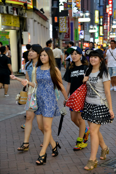 """Youngsters decend into Shibuya area in the evening.<br /> <br /> Tokyo (東京 Tōkyō) """"Eastern Capital"""" is one of the 47 prefectures of Japan. Tokyo is the capital of Japan, the center of the Greater Tokyo Area, and the largest metropolitan area in the world. It is the seat of the Japanese government and the Imperial Palace, and the home of the Japanese Imperial Family. Tokyo is in the Kantō region on the southeastern side of the main island Honshu and includes the Izu Islands and Ogasawara Islands. Tokyo was originally a small fishing village named Edo  which means """"estuary""""."""