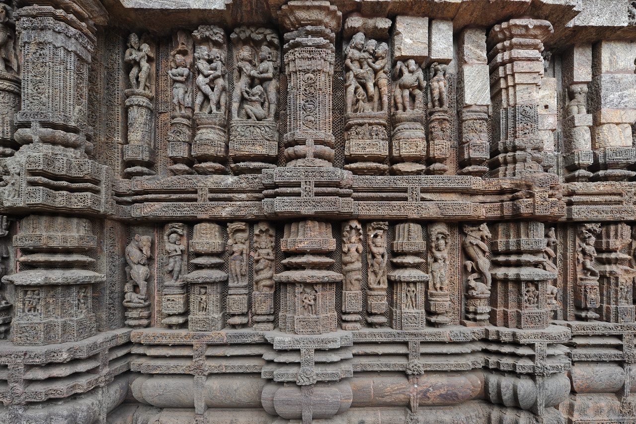Various erotic and sexual pose on display in stone at the Konark Temple.<br /> <br /> Konark Sun Temple in Orissa belongs to the Kalinga school of Indian temples and was constructed by King Narasimhadeva of the Eastern Ganga Dynasty in the 13th Century. This world heritage site temple takes the form of a colossal chariot of Surya (Sun) drawn by seven spirited horses on twelve pairs of exquitely decorated wheels. Surya has been a popular deity in India since the Vedic perios. Thousands of sculptured images depict deities, celestial and human musicians, dancers, lovers, and myriad scenes of courtly life, ranging from hunts and military battles to the pleasures of courtly relaxation. The temple is famous for its erotic stone sculptures, which can be found primarily on the second level of the porch structure.