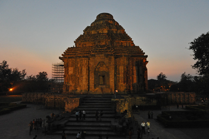 "Night view of the Konark Temple. The main Temple was called by European sailers ""The Black Pagoda"" as it formed an important landmark for them in their coastal voyage. Contrasting to this , the white washed Temple of Lord Jagannath at Puri was known as the white pagoda. <br /> <br /> Konark Sun Temple in Orissa belongs to the Kalinga school of Indian temples and was constructed by King Narasimhadeva of the Eastern Ganga Dynasty in the 13th Century. This world heritage site temple takes the form of a colossal chariot of Surya (Sun) drawn by seven spirited horses on twelve pairs of exquitely decorated wheels. Surya has been a popular deity in India since the Vedic perios. Thousands of sculptured images depict deities, celestial and human musicians, dancers, lovers, and myriad scenes of courtly life, ranging from hunts and military battles to the pleasures of courtly relaxation. The temple is famous for its erotic stone sculptures, which can be found primarily on the second level of the porch structure."