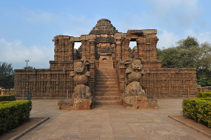 The entrance to Konark Temple is guarded by two giant lions, which are each shown crushing a war elephant which in turn lies on top of a human body. At the entrance of the temple is a Nata Mandir. This is where the temple dancers used to perform dances in homage to the Sun god. The temple symbolizes the majestic stride of the Sun god. <br /> <br /> Konark Sun Temple in Orissa belongs to the Kalinga school of Indian temples and was constructed by King Narasimhadeva of the Eastern Ganga Dynasty in the 13th Century. This world heritage site temple takes the form of a colossal chariot of Surya (Sun) drawn by seven spirited horses on twelve pairs of exquitely decorated wheels. Surya has been a popular deity in India since the Vedic perios. Thousands of sculptured images depict deities, celestial and human musicians, dancers, lovers, and myriad scenes of courtly life, ranging from hunts and military battles to the pleasures of courtly relaxation. The temple is famous for its erotic stone sculptures, which can be found primarily on the second level of the porch structure.