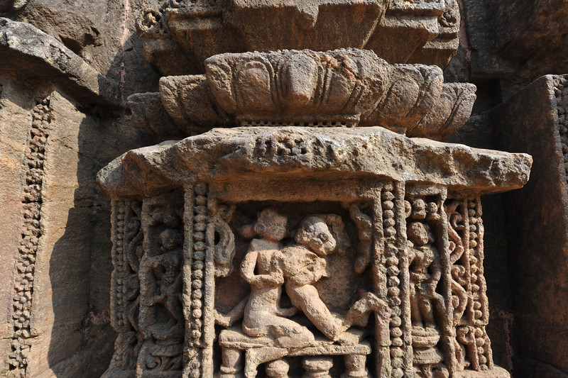 Part of the temple lost in time but still the detailed carvings in stone are quite evident. Various erotic art forms were displayed along with various other images on the walls of the Sun Temple, Konark, Orissa.<br /> <br /> Konark Sun Temple in Orissa belongs to the Kalinga school of Indian temples and was constructed by King Narasimhadeva of the Eastern Ganga Dynasty in the 13th Century. This world heritage site temple takes the form of a colossal chariot of Surya (Sun) drawn by seven spirited horses on twelve pairs of exquitely decorated wheels. Surya has been a popular deity in India since the Vedic perios. Thousands of sculptured images depict deities, celestial and human musicians, dancers, lovers, and myriad scenes of courtly life, ranging from hunts and military battles to the pleasures of courtly relaxation. The temple is famous for its erotic stone sculptures, which can be found primarily on the second level of the porch structure.