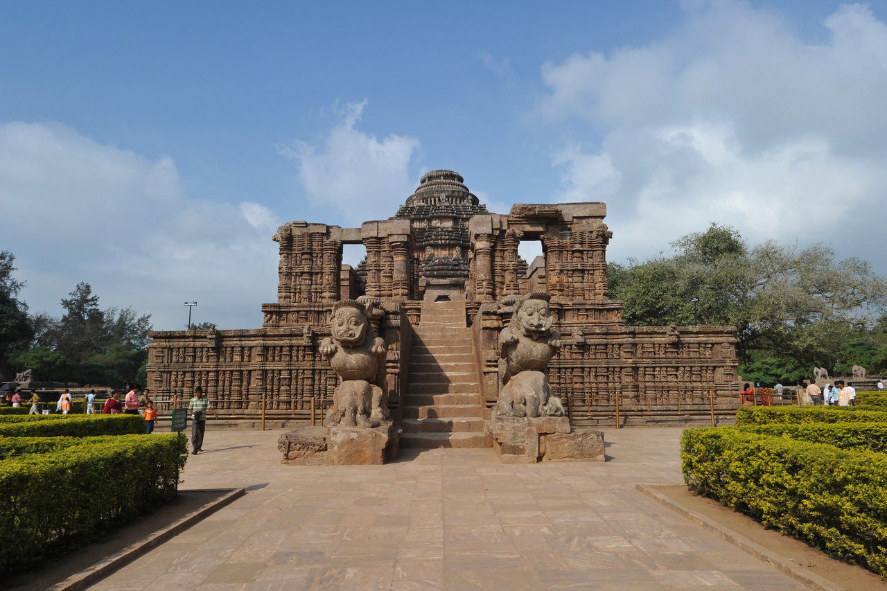 "Entrance to Konark Sun Temple. ""Konarka"" , the place bears a name composed of two World elements : Kona meaning corner and ARKA meaning the Sun. As the legend says that, King Narasimha Deva-I of the Ganga Dynasty had ordered this temple to be built as a royal proclamation of the political supremacy of his dynasty.A workforce of 12 hundred artisans and architects invested their creative talent,energy and artistic commitment for an exhausting period of 12 years.<br /> Konark Sun Temple in Orissa belongs to the Kalinga school of Indian temples and was constructed by King Narasimhadeva of the Eastern Ganga Dynasty in the 13th Century. This world heritage site temple takes the form of a colossal chariot of Surya (Sun) drawn by seven spirited horses on twelve pairs of exquitely decorated wheels. Surya has been a popular deity in India since the Vedic perios. Thousands of sculptured images depict deities, celestial and human musicians, dancers, lovers, and myriad scenes of courtly life, ranging from hunts and military battles to the pleasures of courtly relaxation. The temple is famous for its erotic stone sculptures, which can be found primarily on the second level of the porch structure."