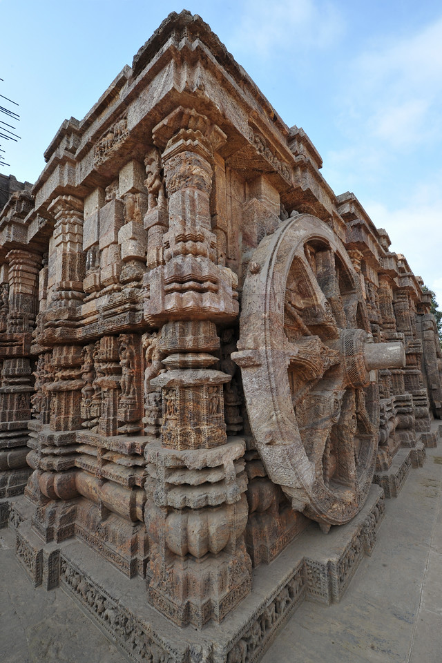 Detailed work done in stone on the massive stone wheels of Konark Sun Temple.<br /> <br /> Konark Sun Temple in Orissa belongs to the Kalinga school of Indian temples and was constructed by King Narasimhadeva of the Eastern Ganga Dynasty in the 13th Century. This world heritage site temple takes the form of a colossal chariot of Surya (Sun) drawn by seven spirited horses on twelve pairs of exquitely decorated wheels. Surya has been a popular deity in India since the Vedic perios. Thousands of sculptured images depict deities, celestial and human musicians, dancers, lovers, and myriad scenes of courtly life, ranging from hunts and military battles to the pleasures of courtly relaxation. The temple is famous for its erotic stone sculptures, which can be found primarily on the second level of the porch structure.