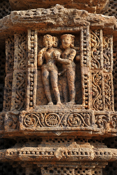 Many erotic art forms depicted on the stone walls of Konark Temple.<br /> <br /> Konark Sun Temple in Orissa belongs to the Kalinga school of Indian temples and was constructed by King Narasimhadeva of the Eastern Ganga Dynasty in the 13th Century. This world heritage site temple takes the form of a colossal chariot of Surya (Sun) drawn by seven spirited horses on twelve pairs of exquitely decorated wheels. Surya has been a popular deity in India since the Vedic perios. Thousands of sculptured images depict deities, celestial and human musicians, dancers, lovers, and myriad scenes of courtly life, ranging from hunts and military battles to the pleasures of courtly relaxation. The temple is famous for its erotic stone sculptures, which can be found primarily on the second level of the porch structure.