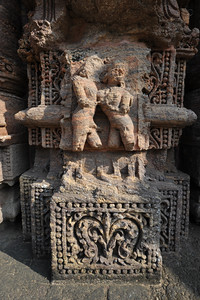 Part of the temple lost in time but still the detailed carvings in stone are quite evident. Various erotic art forms were displayed along with various other images on the walls of the Sun Temple, Konark, Orissa.  Konark Sun Temple in Orissa belongs to the Kalinga school of Indian temples and was constructed by King Narasimhadeva of the Eastern Ganga Dynasty in the 13th Century. This world heritage site temple takes the form of a colossal chariot of Surya (Sun) drawn by seven spirited horses on twelve pairs of exquitely decorated wheels. Surya has been a popular deity in India since the Vedic perios. Thousands of sculptured images depict deities, celestial and human musicians, dancers, lovers, and myriad scenes of courtly life, ranging from hunts and military battles to the pleasures of courtly relaxation. The temple is famous for its erotic stone sculptures, which can be found primarily on the second level of the porch structure.