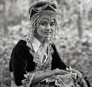 Young Hamoung woman in a forest outside the village of Naoen.  Laos, 2010.