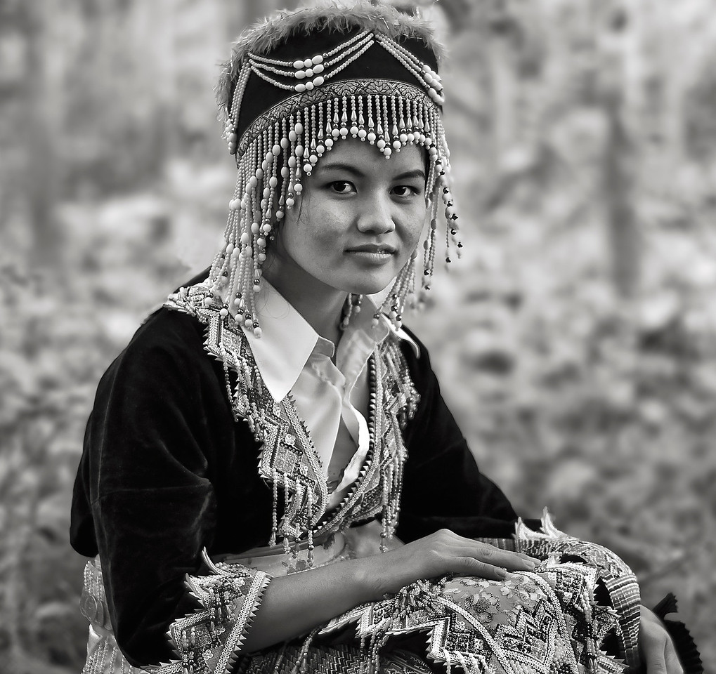 Young Hamoung woman in a forest outside the village of Naoen.<br /> <br /> Laos, 2010.
