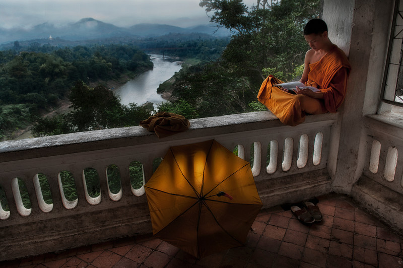 In most Theravada countries, it is a common practice for young men to ordain as monks for a fixed period of time. In Thailand and Burma, young men typically ordain for the 3 month Rain Retreat (vassa), though shorter or longer periods of ordination are not rare. Traditionally, temporary ordination was even more flexible among Laotians. Once they had undergone their initial ordination as young men, Laotian men were permitted to temporarily ordain again at any time, though married men were expected to seek their wife's permission. Throughout Southeast Asia, there is little stigma attached to leaving the monastic life. Monks regularly leave the robes after acquiring an education, or when compelled by family obligations or ill health.<br /> <br /> Monk studying, Luang Prabang, Laos, 2010.