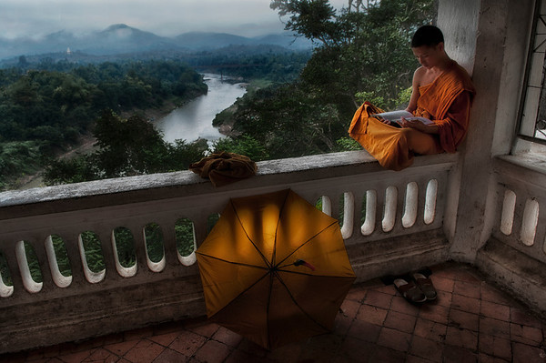 In most Theravada countries, it is a common practice for young men to ordain as monks for a fixed period of time. In Thailand and Burma, young men typically ordain for the 3 month Rain Retreat (vassa), though shorter or longer periods of ordination are not rare. Traditionally, temporary ordination was even more flexible among Laotians. Once they had undergone their initial ordination as young men, Laotian men were permitted to temporarily ordain again at any time, though married men were expected to seek their wife's permission. Throughout Southeast Asia, there is little stigma attached to leaving the monastic life. Monks regularly leave the robes after acquiring an education, or when compelled by family obligations or ill health.  Monk studying, Luang Prabang, Laos, 2010.