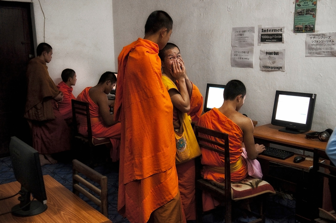 Monks in an internet cafe.<br /> <br /> Luang Prabang, Laos, 2010.