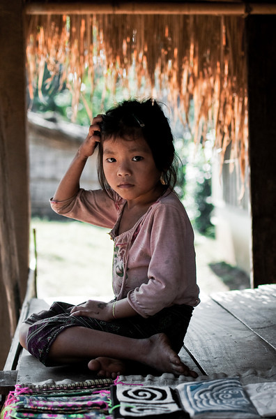 Young girl selling hand made products in the Hamoung village of Naoen.<br /> <br /> Laos, 2010.