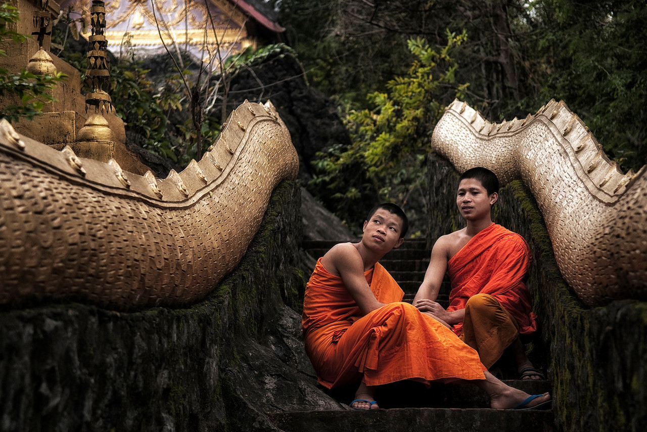 Two Buddhist monks in the  Mount Phou Si temple in Luang Prabang.<br /> <br /> Luang Prabang, Laos, 2010