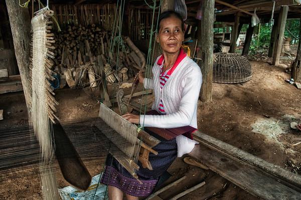 Woman weaving in the village of Ban Phanom.  Laos, 2010