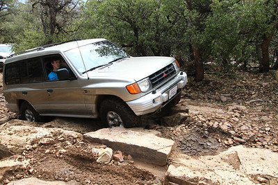 First attempt to the left.  Not so good.  Wheelbase perfectly stuck in the rocks