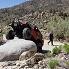 "Zack (MonsterRuby) climbs the rock.  10"" lift, 38"" tires, stock axles and lockers...."