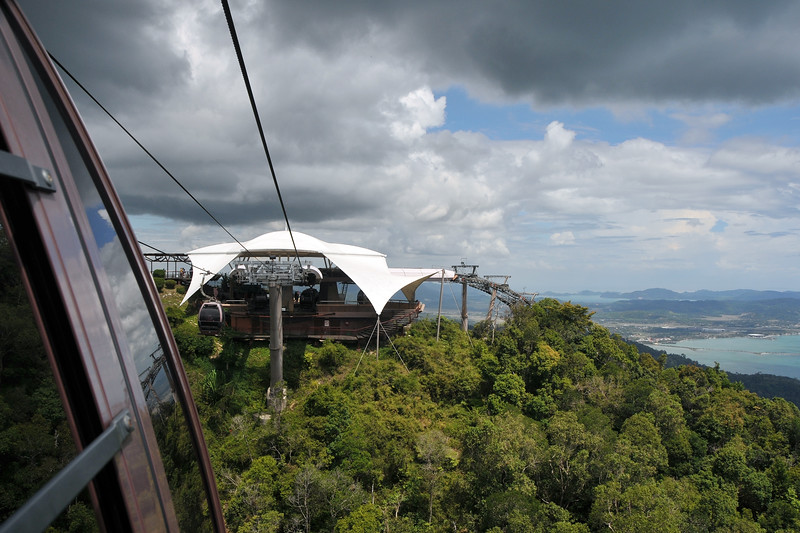 View from the cable car window of Mat Chinchang Hill which is accessible by cable car from sea level. Great bird's eye view of major parts of Langkawi, Malaysia. Langkawi Sky Bridge is the world's steepest cable car and provides an experience of Langkawi from the highest perspective. The Sky Bridge hangs 100 meters above the ground; 708 meters above sea level.