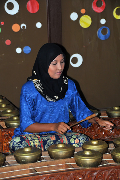 Caklempong - musc being played by malay girls at the entrance. Malay village recreated with houses, music, and dance in Langkawi, Malaysia.