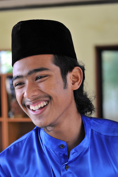 Staff at Malay village recreated with houses, music, and dance in Langkawi, Malaysia