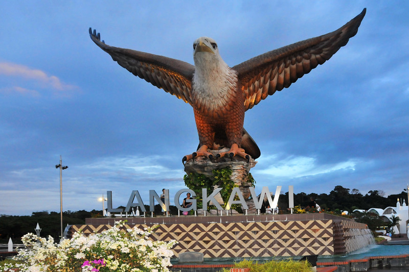 "Eagle Square / Dataran Lang is Langkawi's most prominent landmark for visitors arriving by sea and also a place visited by others. Situated near the Kuah jetty, the main attraction of the square is the magnificent statue of the reddish brown eagle majestically poised for flight. According to local folklore, the name Langkawi itself is derived from- the eagle or ""helang"". In old Malay, ""kawi"" denotes reddish brown - hence, Langkawi means reddish brown eagle!"
