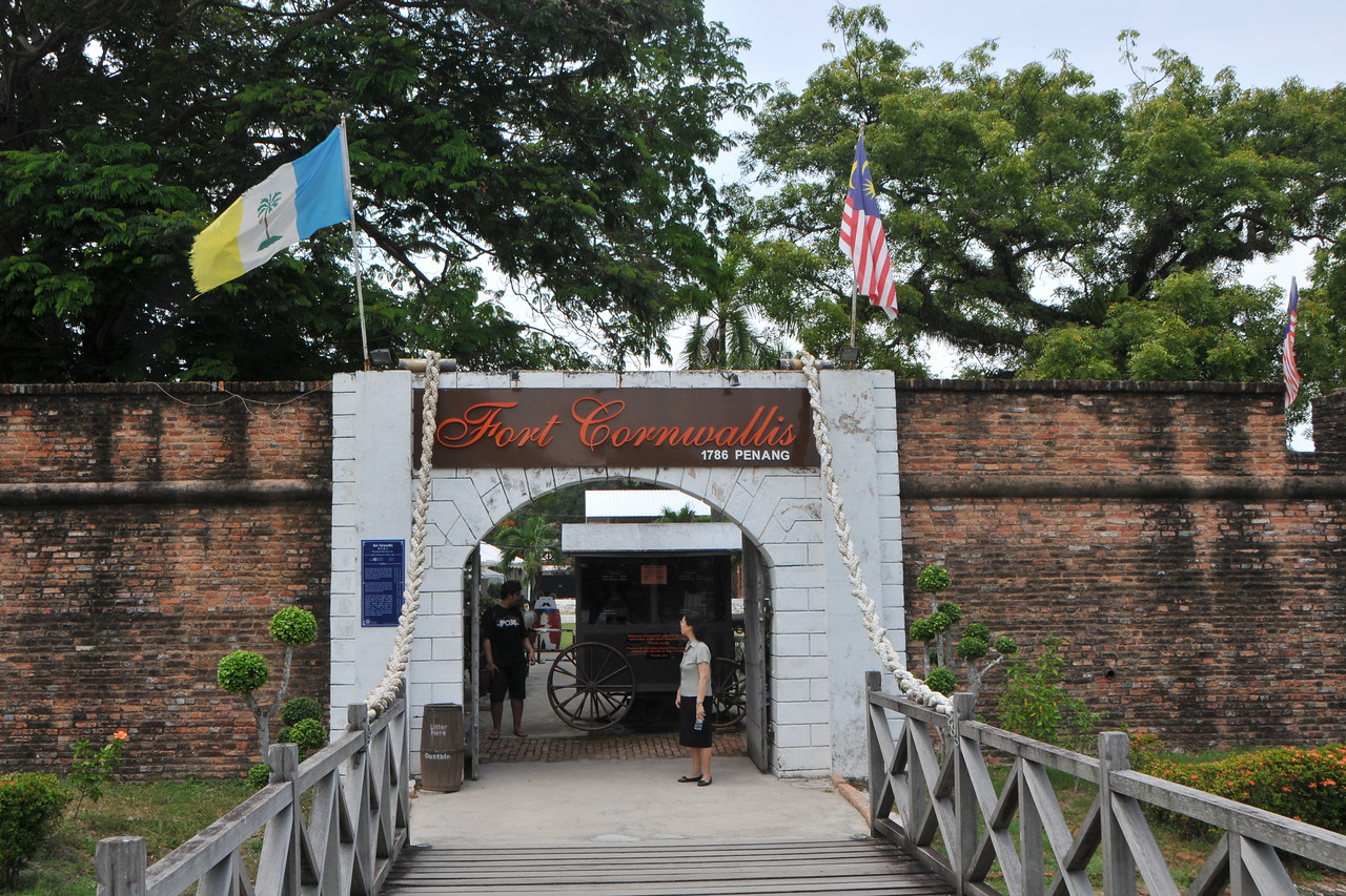 "Fort Cornwallis, Penang. Soon after taking posession in 1786, Francis Light erected a fort at the tip of the cape and named it after the Governor General of Bengal - Charles Cornwallis. This was the first military and administrative base of the East India Company.<br /> <br /> Penang (pronounced /pəˈnæŋ/; (Malay: Pulau Pinang)) is a state in Malaysia which is located on the north-west coast of Peninsular Malaysia by the Strait of Malacca. The name ""Penang"" comes from the modern Malay name Pulau Pinang, which means island of the betel nut tree. It is the second smallest state in Malaysia. Penang is often known as ""The Pearl of the Orient"" and ""Pulau Pinang Pulau Mutiara"" (Penang Island of Pearls)."
