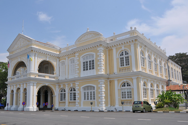 "Town Hall building.<br /> Penang (pronounced /pəˈnæŋ/; (Malay: Pulau Pinang)) is a state in Malaysia which is located on the north-west coast of Peninsular Malaysia by the Strait of Malacca. The name ""Penang"" comes from the modern Malay name Pulau Pinang, which means island of the betel nut tree. It is the second smallest state in Malaysia. Penang is often known as ""The Pearl of the Orient"" and ""Pulau Pinang Pulau Mutiara"" (Penang Island of Pearls)."