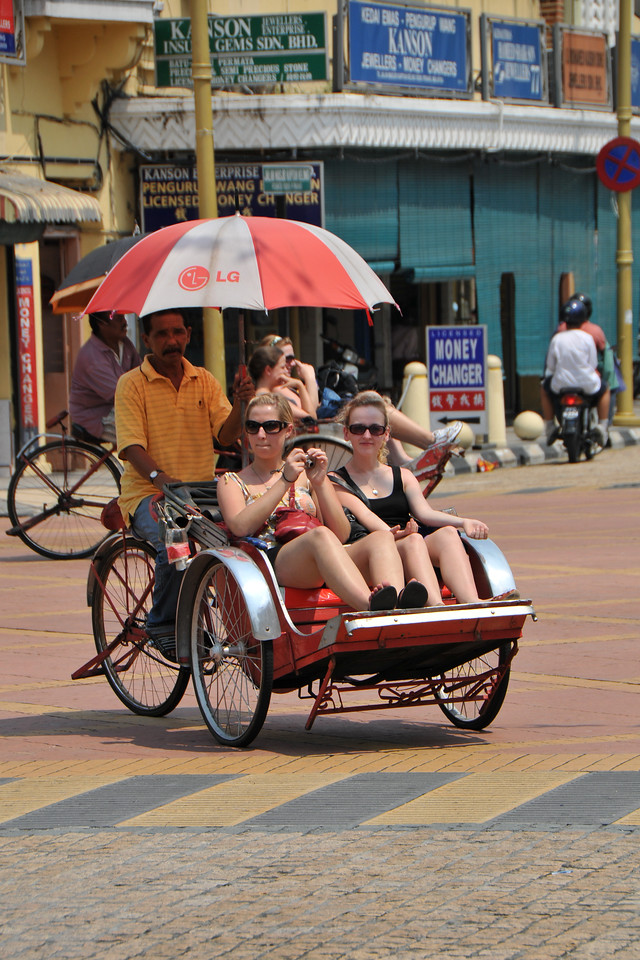 "Tourists on Tricycle outside the Hindu Indian Temple.<br /> Penang (pronounced /pəˈnæŋ/; (Malay: Pulau Pinang)) is a state in Malaysia which is located on the north-west coast of Peninsular Malaysia by the Strait of Malacca. The name ""Penang"" comes from the modern Malay name Pulau Pinang, which means island of the betel nut tree. It is the second smallest state in Malaysia. Penang is often known as ""The Pearl of the Orient"" and ""Pulau Pinang Pulau Mutiara"" (Penang Island of Pearls)."