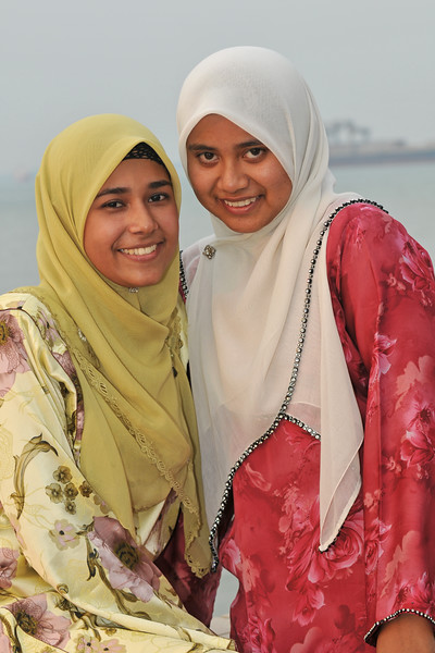 """Portraits of Malay girls at the Esplanade, Penang.<br /> Penang (pronounced /pəˈnæŋ/; (Malay: Pulau Pinang)) is a state in Malaysia which is located on the north-west coast of Peninsular Malaysia by the Strait of Malacca. The name """"Penang"""" comes from the modern Malay name Pulau Pinang, which means island of the betel nut tree. It is the second smallest state in Malaysia. Penang is often known as """"The Pearl of the Orient"""" and """"Pulau Pinang Pulau Mutiara"""" (Penang Island of Pearls)."""