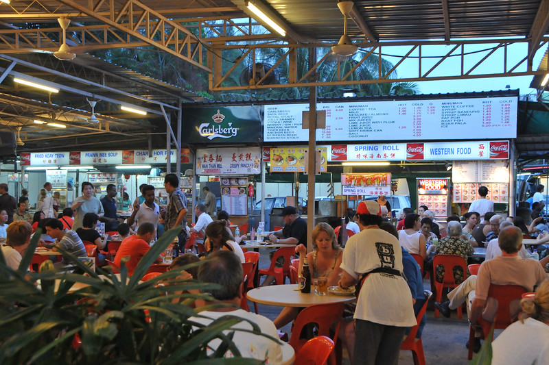 """Lots of tourists particularly Australian at the Street food place in Batu Feringgi. <br /> <br /> Penang (pronounced /pəˈnæŋ/; (Malay: Pulau Pinang)) is a state in Malaysia which is located on the north-west coast of Peninsular Malaysia by the Strait of Malacca. The name """"Penang"""" comes from the modern Malay name Pulau Pinang, which means island of the betel nut tree. It is the second smallest state in Malaysia. Penang is often known as """"The Pearl of the Orient"""" and """"Pulau Pinang Pulau Mutiara"""" (Penang Island of Pearls)."""