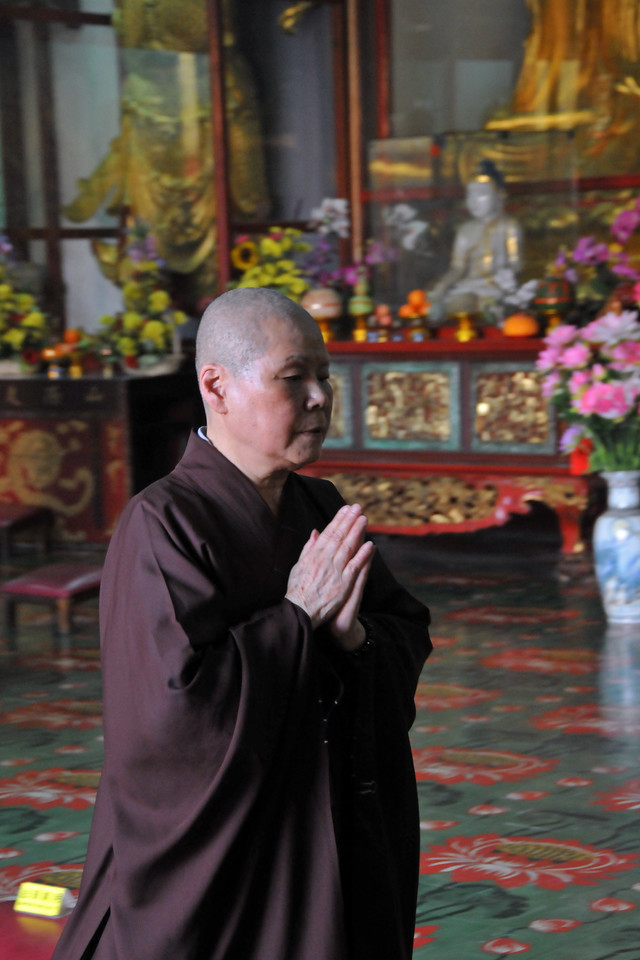"Monk praying at Kek Lok Si Temple (Penang Hokkien for ""Temple of Supreme Bliss""). This is a Buddhist temple situated in Air Itam, Penang and is one of the best known temples on the island. Mahayana Buddhism and tradional Chinese rituals blend into a harmonious whole, both in the temple architecture and artwork as well as in the daily activities of worshippers."