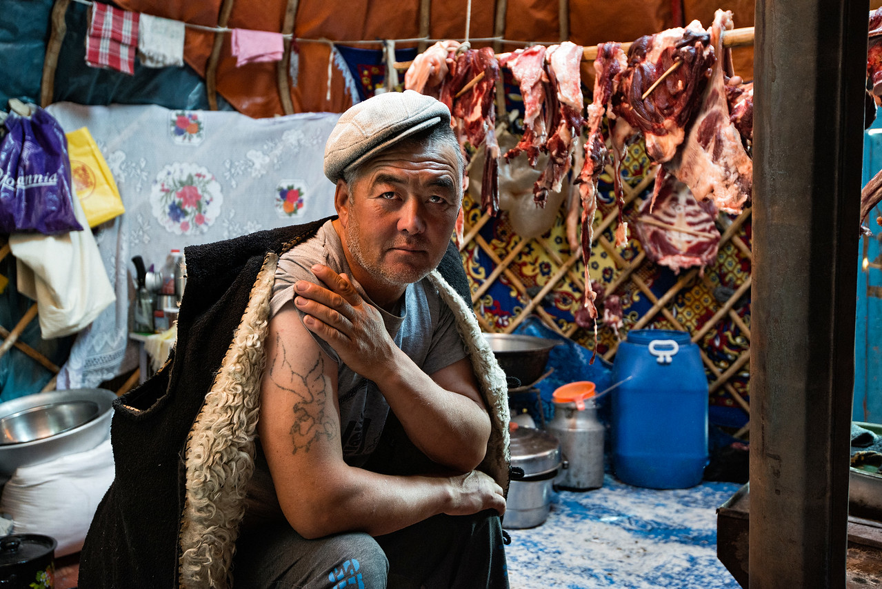 Mr Shamurat is a 52 year old eagle hunter. He lives a nomadic life together with his family in the Mongolian province of Bayan Olgii. Mr Shamurat and his wife have one daughter aged 20, and two sons aged 15 and 13. He also owns 150 goats, 80 sheep, 14 cows and 30 horses. But his most priced possession is a large golden eagle which he uses to hunt for rabbit and foxes, as evidenced by the tatoo on his arm.