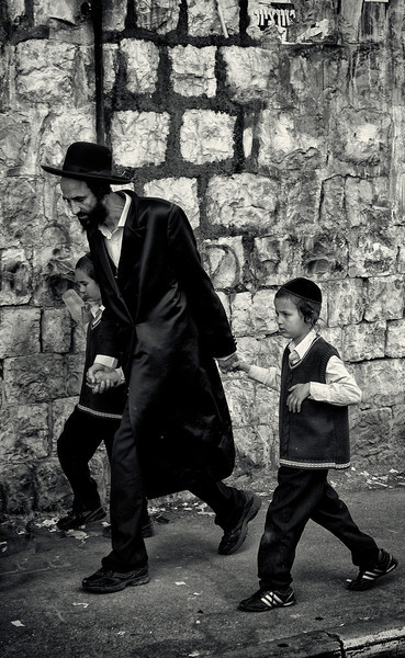 Because most varieties of secular education are frowned upon, few haredim hold professional degrees. Most adult men devote themselves to full-time Torah study, and their wives commonly assume the role of breadwinner. Because most haredim live in single-earner households with large numbers of children, haredi communities are generally characterized by extreme poverty, requiring subsidies from charities and governments in order to subsist. However, in recent years, a new haredi upper-class has emerged, Children of the haredi upper-class attend the same yeshivot as their less-privileged peers, while their parents direct a very large portion of their income to communal charities and funds that support major rabbinic figures and their projects.
