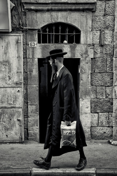 The distinctive dress of Haredi Jews helps them to define, and then insulate, their communities, as well as maintain a traditional and spiritual focus. They dress as their ancestors dressed in 18th and 19th century Europe. The men tend to wear dark suits with white shirts, and to cover their heads with black, wide-brimmed hats. The men also generally have beards and sidelocks (peyot). Women, in line with strict standards of modesty, tend to wear long skirts and shirts with long sleeves and high necklines. After the women get married, they cover their heads with either scarves, hats or wigs.