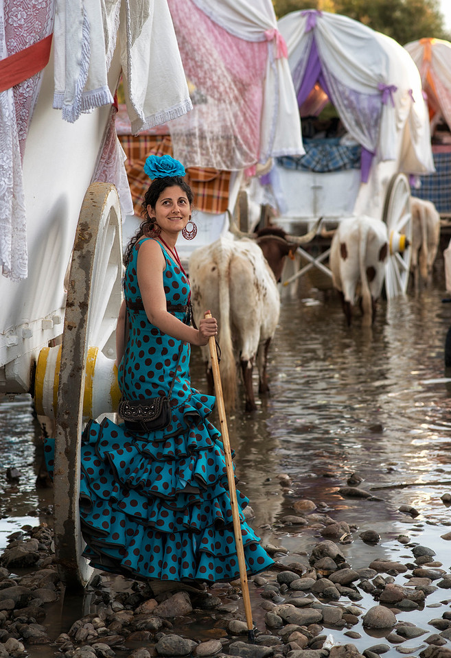 """A pilgrim takes a rest in the famous """"Vado del Quema"""" river, were it is customary for first time pilgrims to get baptised as """"Rocieros""""."""