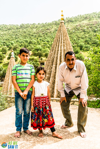 Yazidi father poses with his children