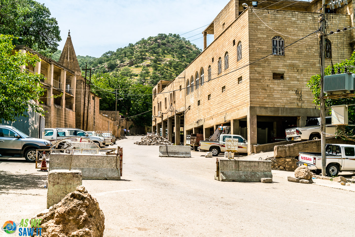 Concrete barriers in the road protect the entrance to Lalish from large vehicles.