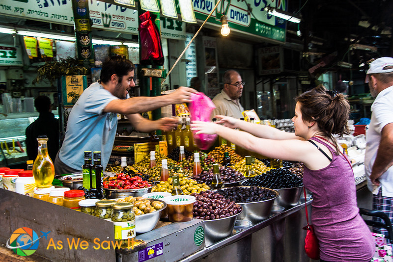 This vendor of olives exchanges a selection for Shekels, the Israeli currency.