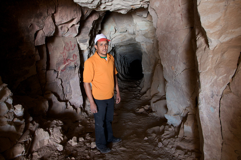 One of the hiking guides showing me an old mining cave