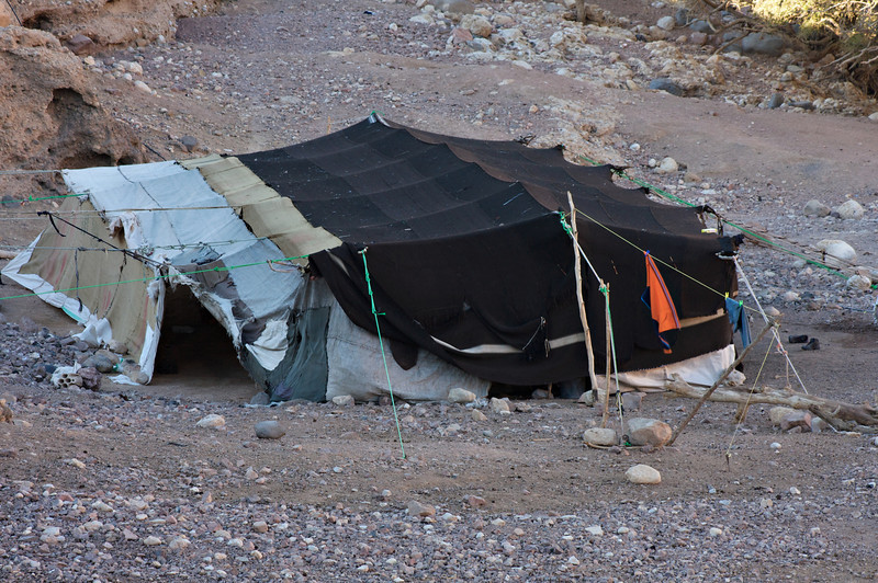 A Bedouin home.  The black color is used for the winter and a whole family would live in this massive tent...along with the occasional animal!