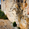 Bullet holes scar 50% buildings