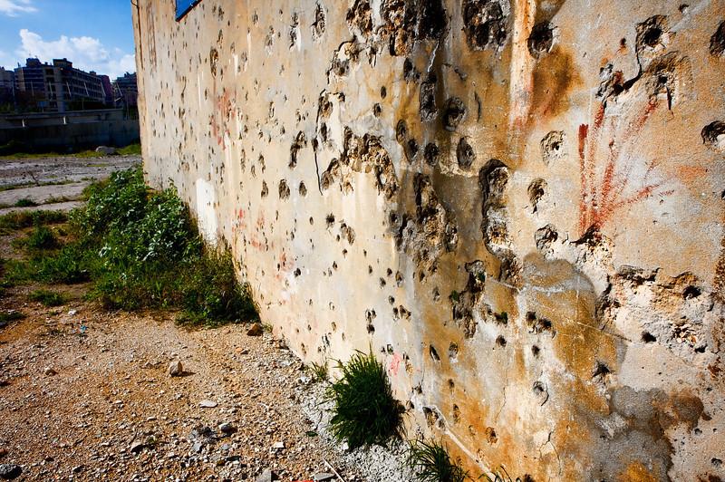 Bullet holes scar 50% buildings