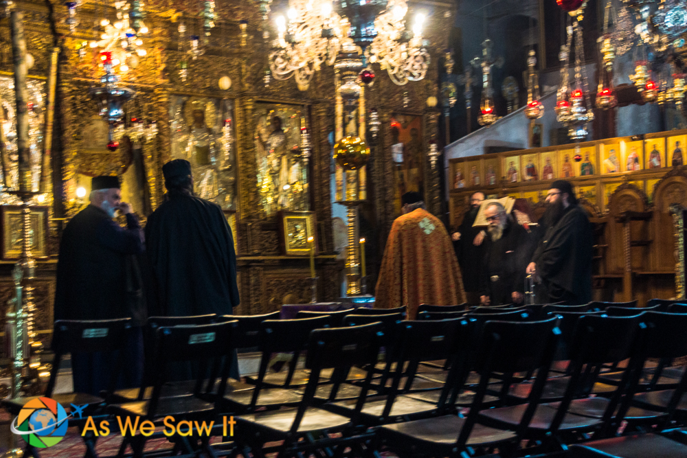 Greek Orthodox priests at altar in Church of the Nativity