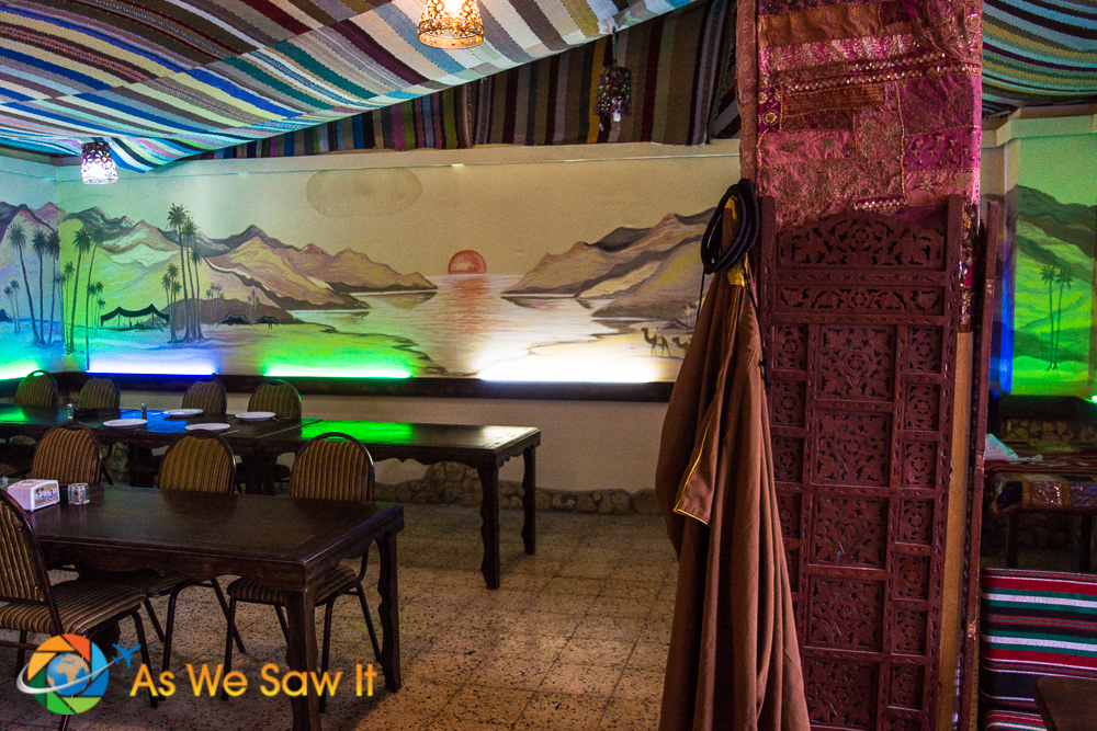 Restaurant has fabric-draped ceiling and a wall mural of the Jordan valley.