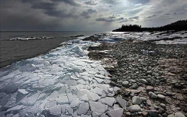 Plate ice on the shores of Lake Superior, near Split Rock Lighthouse, Minnesota. Soon the waves washed the ice back off the rocks, #0040